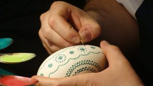 Hand painting an Easter egg